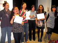 Award participants standing holding their certificates.