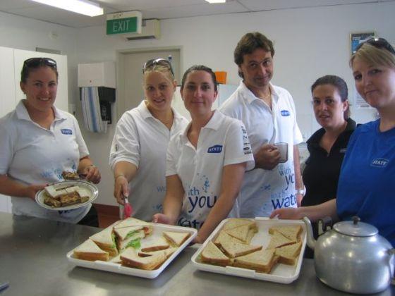 Team of volunteers serving sandwiches